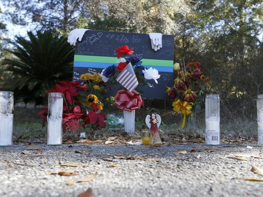 A memorial is set outside of the house on Caracus Court where Leon County Deputy Christopher Smith was gunned down Nov. 22, 2014.