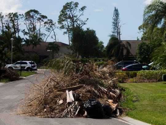 Piles and piles of debris, leftovers from Hurricane Irma over a month ago, litter Sloan Place in the Berkshire Lakes neighborhood Thursday, Oct. 19, 2017, in East Naples. With Halloween only a week away how will trick-or-treating be affected by the nuisance, if at all?