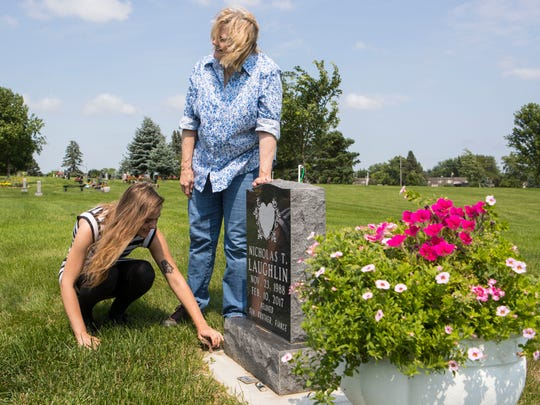 Anna Welter (left), Nick Laughlin's fiance and Shelley Johnson, Nick's mother, visit his grave at Woodlawn Cemetery in Sioux Falls, S.D. Tuesday, July 3, 2018.
