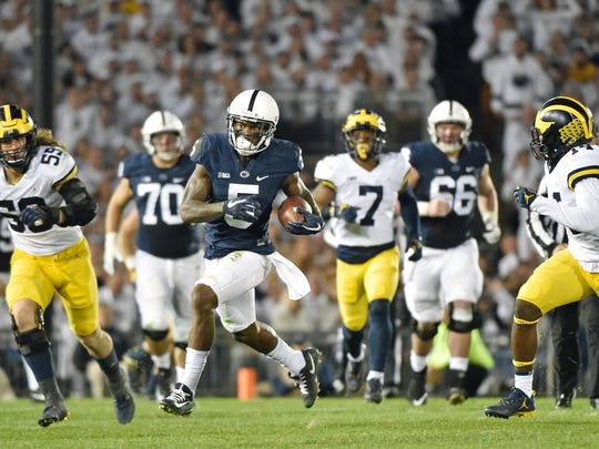 Penn State's DaeSean Hamilton carries the ball against Michigan in the second half of an NCAA Division I college football game Saturday, Oct. 21, 2017, at Beaver Stadium. The No. 2 Penn State Nittany Lions defeated Michigan 42-13, improving their season record to 7-0.