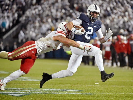 Penn State's Tommy Stevens carries the ball against Nebraska's Marcus Newby in the first half of an NCAA Division I football game Saturday, Nov. 18, 2017, at Beaver Stadium. Penn State defeated Nebraska 56-44 in its final home game of the 2017 season.