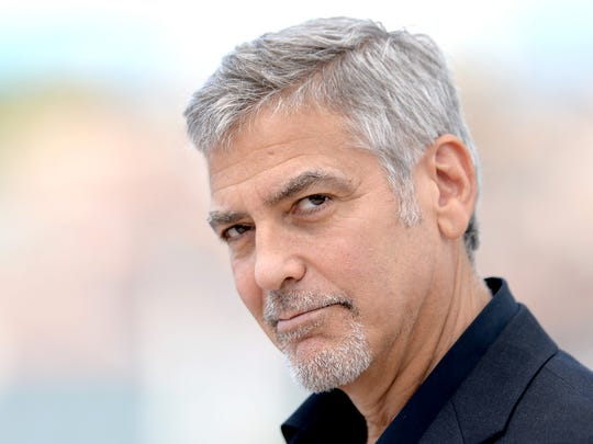 George Clooney assumes the pose at Cannes.