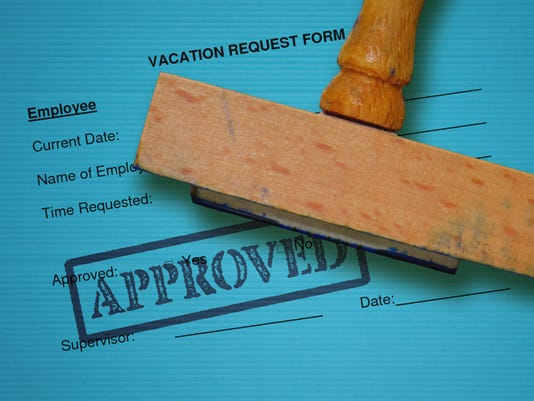 Vacation request form and wooden stamp on blue background