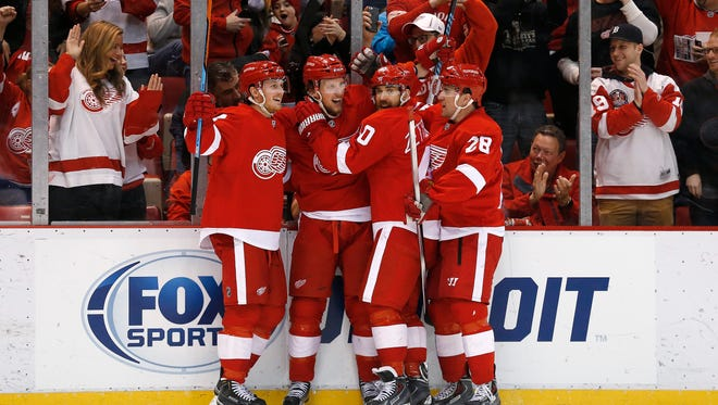 Detroit Red Wings left wing Justin Abdelkader, second from left, celebrates his goal against the Tampa Bay Lightning with Gustav Nyquist, left, Henrik Zetterberg, third from left, and Marek Zidlicky (28) in the second period March 28, 2015.