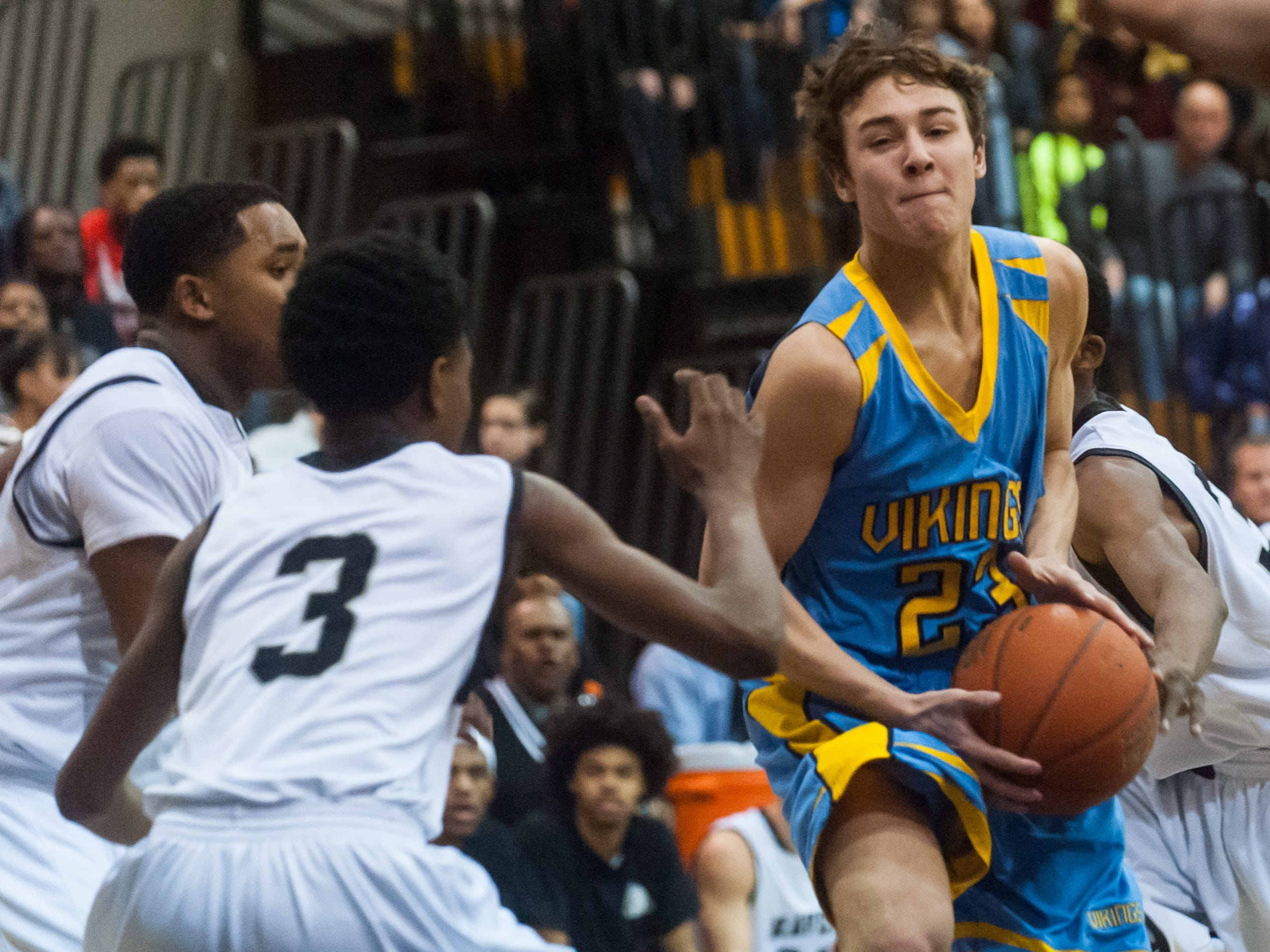 Cape Henlopen guard Drew Mulcahy (23) looks to pass against Sussex Tech on Friday night at Sussex Tech.