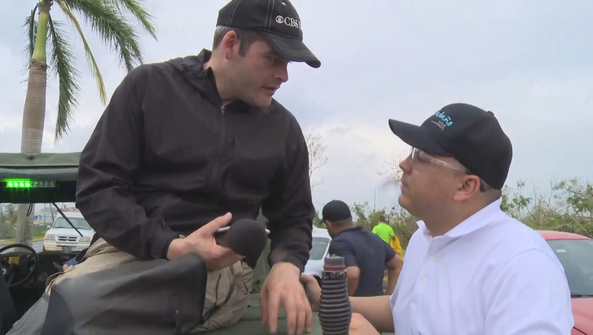 David Begneaud interviewing officials abuot the disaster