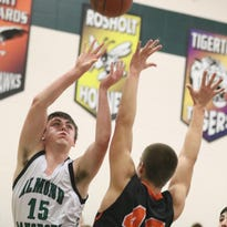 Port Edwards' Jared Joslin goes against Almond-Bancroft's Allan Zinda during a Central Wisconsin Conference basketball game at Almond-Bancroft High School, Thursday, Feb. 11, 2016. Almond-Bancroft defeated Port Edwards in overtime 53-47.