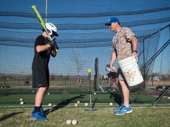 Chris Renn works with players during batting practice at Nelson Farm Ballpark in Johnstown on April 25, 2018. Renn is head coach of the youth club team.