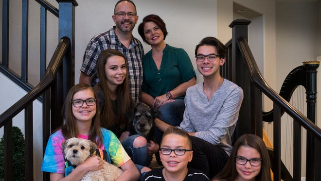 Tom and Wendy Montgomery supported their son Jordan when they discovered he was gay. (Clockwise from top left), Tom, Wendy, Jordan, Emma, Ethan, Kate and Susannah June 9, 2017, in their Chandler, Az., home.