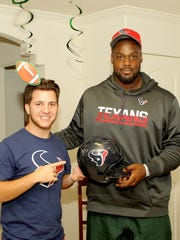 Houston Texans defensive tackle Joel Heath, right, poses with Conner Gelinas during a birthday party at the Gelinases' home in Houston on Tuesday, Sept. 20, 2016. Gelinas, 20, has befriended Heath after being diagnosed with a rare form of sinus cancer.