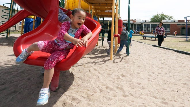 Ariane Cuellar Valles, a student at Robert F. Kennedy Pre-K Center at 9009 Alameda, enjoys the playground before the end of the school day Monday in El Paso's Lower Valley. The school has an enrollment of 475 students in two shifts, said principal Espie Flores. The school, which is up for sale, will close at the end of the school year.