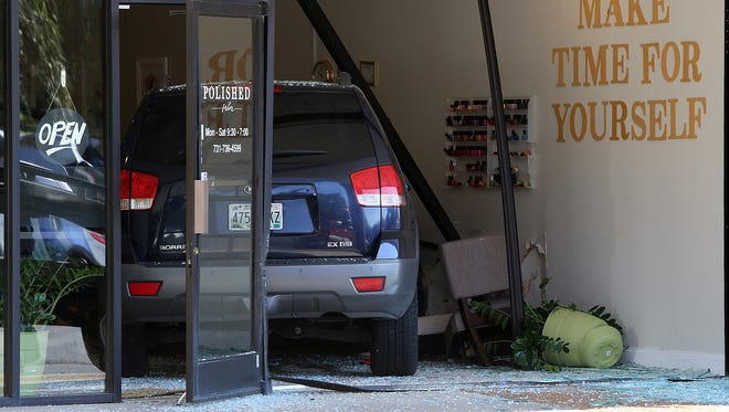 A crashed SUV is seen inside Polished Salon off of Union University Drive in Jackson, Tenn., on Thursday, Sept. 22, 2016.