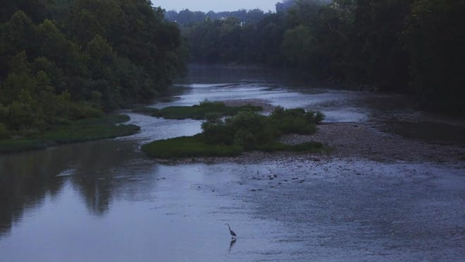 A peaceful scene early Wednesday on the Little Miami in Newtown after strong storms moved through earlier.