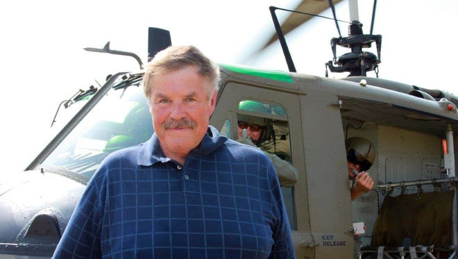 Tom Mackie at the 2012 Dayton Airshow taking a ride on a UH-1 Huey helicopter. Mackie piloted the same aircraft in Vietnam from 1970-71.