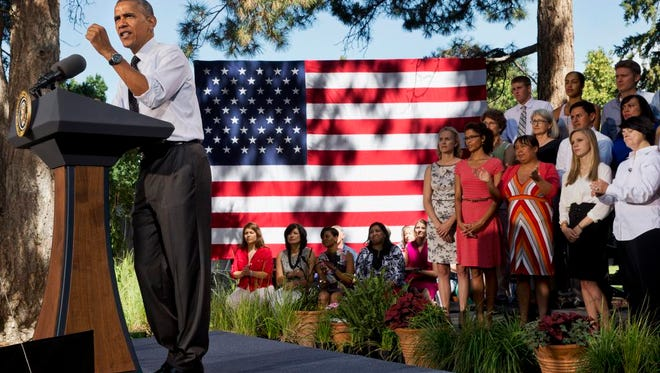 President Barack Obama speaks about the economy, Wednesday, July 9, 2014, at Cheesman Park in Denver. Later Wednesday, the president travel to Texas. (AP Photo/Jacquelyn Martin)