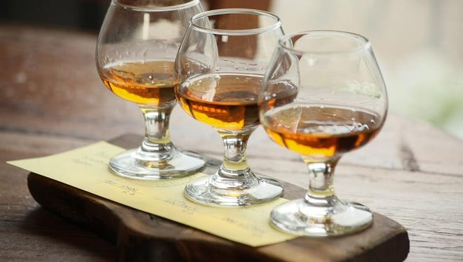 The Single Barrel Flight with Four Roses, Elmer T Lee, and Evan Williams at Harvest Restaurant in Louisville, KY. June 3, 2014