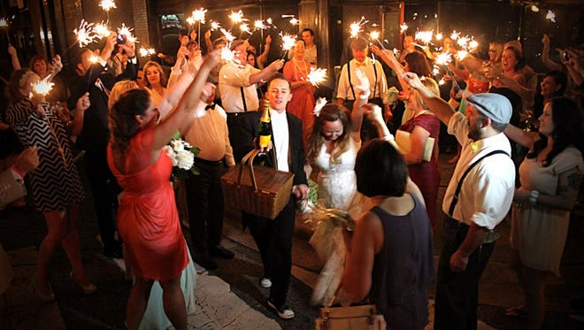 A '20s-style wedding is celebrated in style at the Palafox House.
