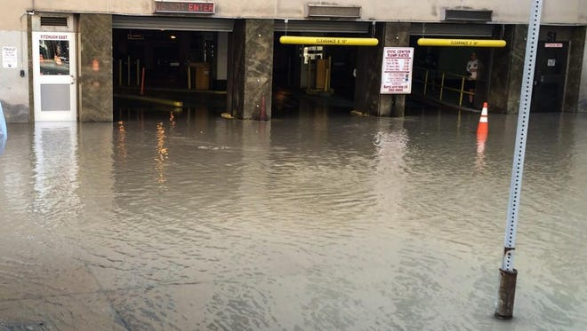 Flooding outside the Civic Center garage Tuesday.