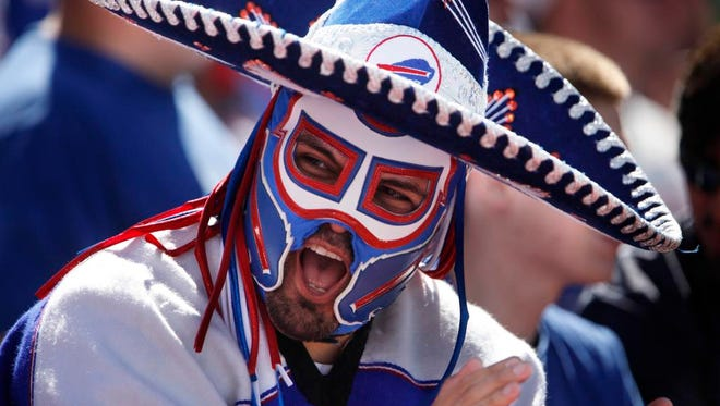Ezra Castro, a fan of the Buffalo Bills dresses as his character, Pancho Billa, and cheers for the Bills early on the match against the New England Patriots, Sunday, September 8, 2013.