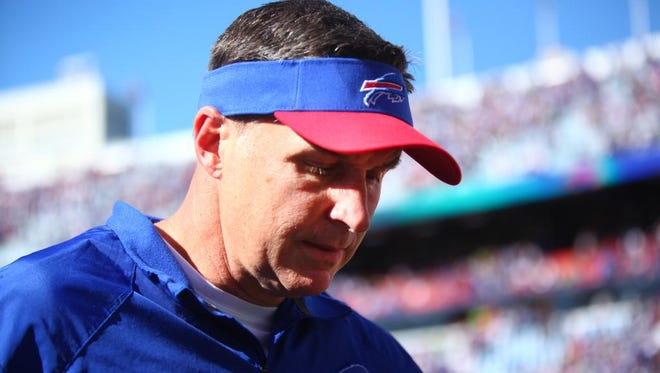Buffalo Bills' head coach Doug Marrone walks out of the field after the Bills lost 23-21 to the New England Patriots, Sunday, September 8, 2013.