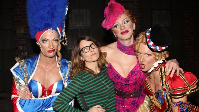 """Kyle Post, left,  Fey, Joey Taranto and Paul Canaan (posing like """"Mean Girls"""")   at a show of the """"Kinky Boots"""" musical on Broadway in 2013 in New York City."""