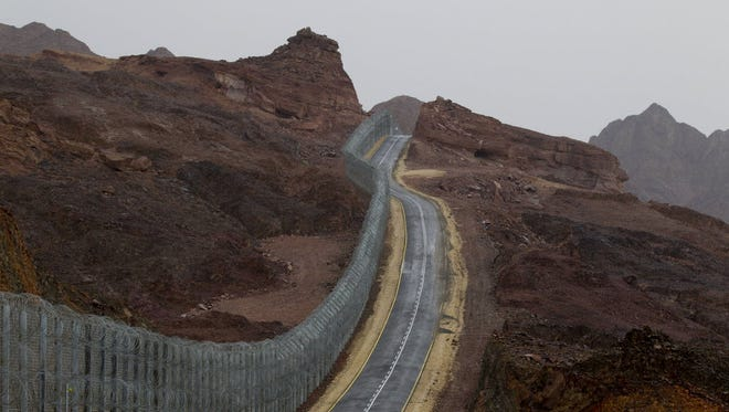 A street runs along the Egypt-Israel border security barrier near the Red Sea resort city of Eilat, southern Israel.