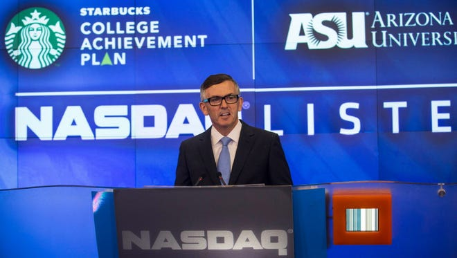 Cliff Burrows, group president for Starbucks in the Americas and Teavana, speaks at the opening bell of the Nasdaq exchange on Tuesday in New York City.