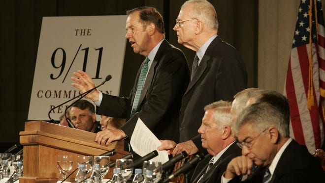 Tom Kean, left, and Lee Hamilton deliver the final report of their 9/11 Commission in Washington on July 22, 2004.