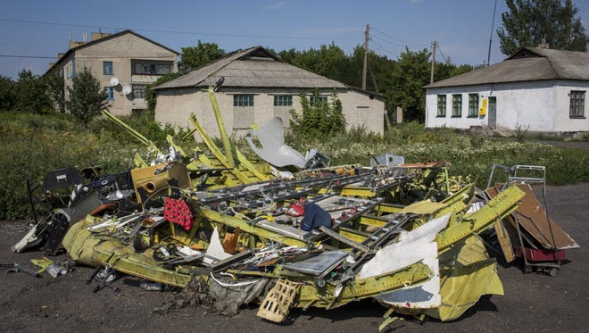 Wreckage of the Malaysia Airlines flight MH17 lies in the road on July 24, 2014 in Petropavlivka, Ukraine.