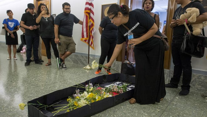 Immigration reform activists place a mock coffin that reads 'RIP GOP' outside the office of Sen. Ted Cruz of Texas last month.