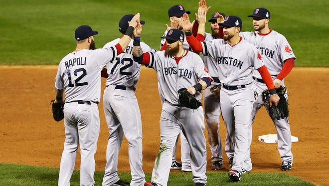 The Boston Red Sox beard brigade celebrates their 4-2 win over the St.Louis Cardinals in Game 4 of the World Series on Sunday. The series' ratings helped Fox win the week overall.