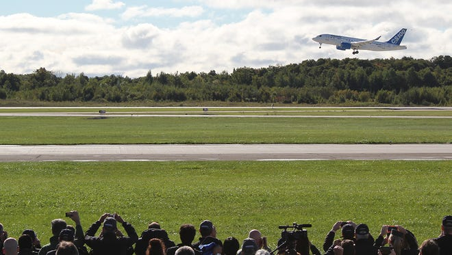 Bombardier's new CSseries aircraft is shown in Mirabel, Quebec, after taking on its maiden flight on Sept. 16, 2013.