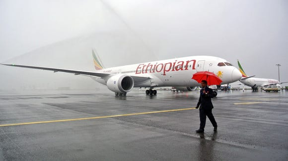One of Ethiopian Airlines' Boeing 787 Dreamliners is hosed down on arrival in Addis Ababa on Aug. 17, 2012.