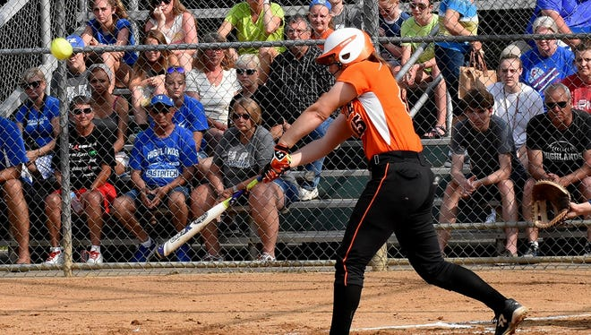 Hannah Bishop lifts a fly ball into play for Ryle at the KHSAA 9th Region Softball Championship, June 1, 2018.