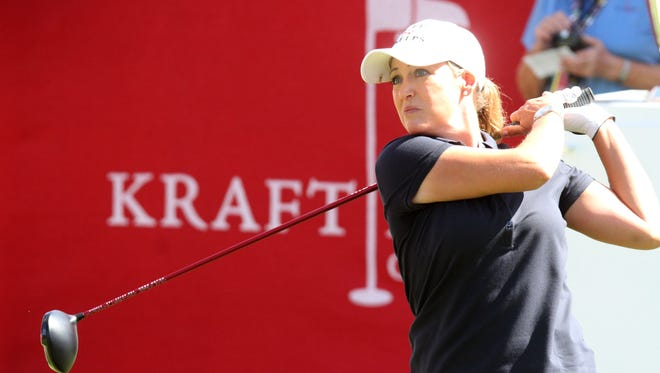 American Cristie Kerr tees off during the first round of the 2014 Kraft Nabisco Championship on Thursday at the Mission Hills Country Club in Rancho Mirage.