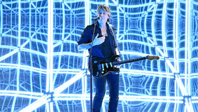 Keith Urban featuring Carrie Underwood performs during the 59th Annual Grammy Awards at Staples Center.