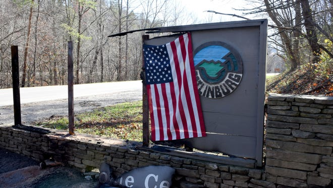 An American flag has been hung at the entrance to Gatlinburg on Thursday, Dec. 1, 2016 following the devastating fires on Monday night.