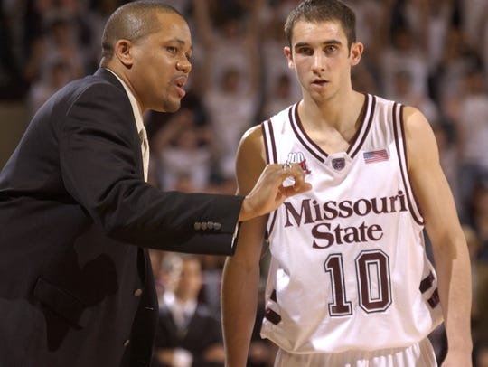 MSU assistant coach Steve Woodberry, left, talks with