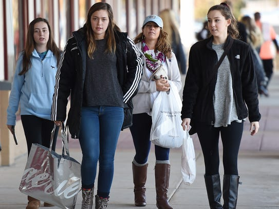 Black Friday shoppers come out early on a chilly morning looking for bargains at the Tanger Outlets near Rehoboth Beach on Friday, Nov. 24.