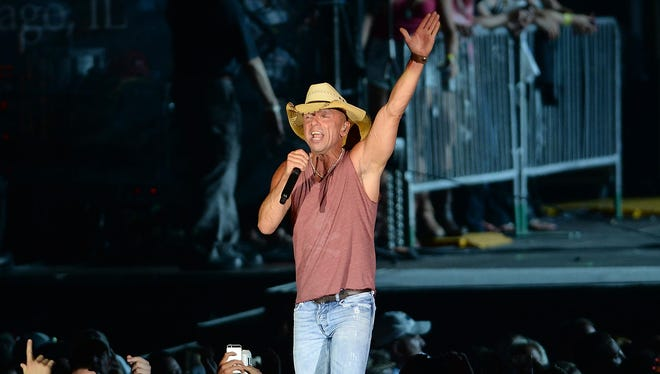 Kenny Chesney sings to more than 50,000 fans at Lambeau Field on June 20.