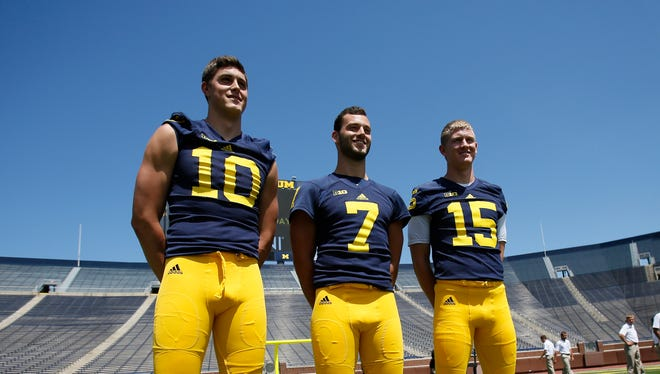 Michigan quarterbacks left to right Zach Gentry, Shane Morris, and Jake Rudock pose for photos during the team's football media day on Thursday, August 6, 2015, in Ann Arbor.