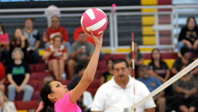 Centennial's Andrea Garcia goes up for a kill on Saturday afternoon against Valencia at Centennial High School.