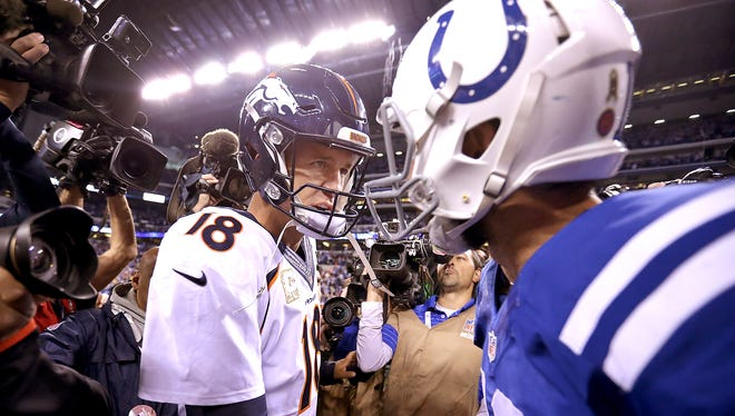 Denver Broncos quarterback Peyton Manning (18) greets Indianapolis Colts quarterback Andrew Luck (12) following their game.  The Indianapolis Colts defeated the Denver Broncos 27-24 Sunday, November 8, 2015, afternoon at Lucas Oil Stadium.