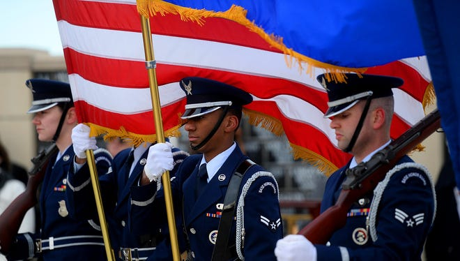The Malmstrom Air Force Base Honor Guard presents the colors during the Veterans Day ceremony at the Montana Veterans Memorial on Wednesday.