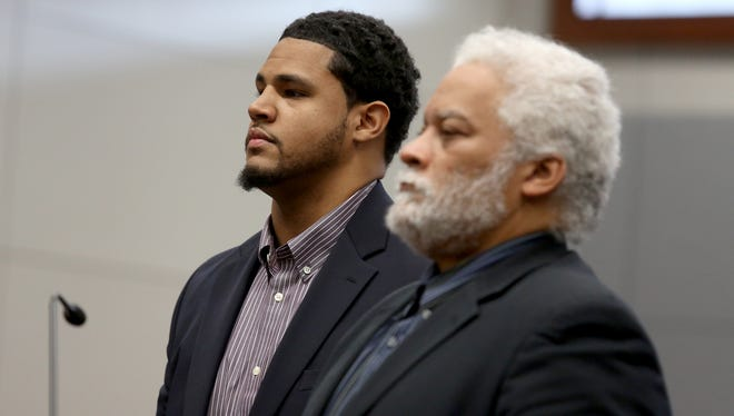 Former University of Michigan football player Logan Tuley-Tillman, left,  and his attorney Douglas Lewis listen to Judge J Cedric Simpson at the Washtenaw County District Court during Tuley-Tillman's preliminary hearing in Ann Arbor on Thursday, Nov. 18, 2015.