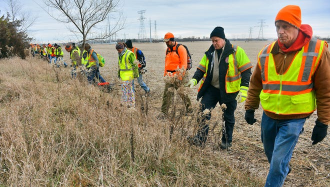 A team of about 60 volunteers search for Tyler Berg, a missing 24-year-old St. Cloud man, in a wooded area on the southwest edge of Monticello in November. United Legacy, a nonprofit search, rescue and recovery organization, helped coordinate the search.