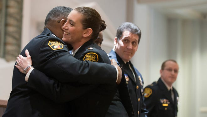 Tonya Thompson hugs Police Chief Ernest Finley after being promoted to Police Captain during the Montgomery Police Department Promotional Ceremony on Friday, Jan. 15, 2016, at City Hall in Montgomery, Ala.