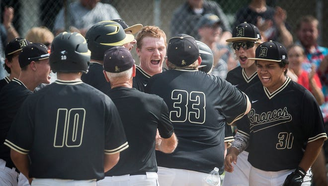 Daleville celebrates after scoring against Cowan during their sectional game at Daleville High School Thursday, May 26, 2016.