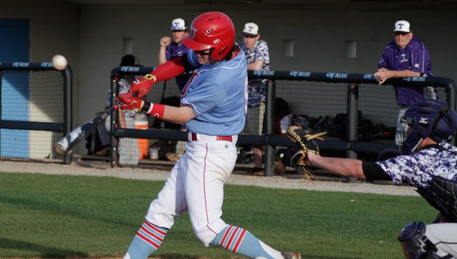Logan Carey hits the ball as TCA takes on USJ at USJ during a game last year.