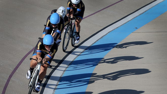 FILE PHOTO The Marian University Men's pursuit cycling team puts in some laps while practicing Thursday, September 10, 2015, at the Major Taylor Velodrome at 3649 Cold Spring Rd.